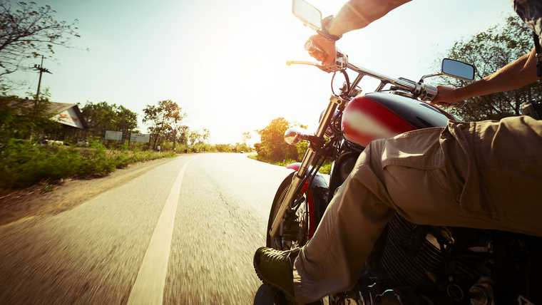 adventure; asphalt; bar; bike; biker; blur; chopper; chrome; cruise; driver; empty; freedom; fun; hands; highway; holding; lane; metal; mirror; motion; moto; motor; motorbike; motorcycle; outdoor; pov; powerful; reflection; rev; ride; rider; road; route; speed; speedometer; steel; steering; sun; sunny; tilt; transport; transportation; travel; tree; vehicle; vintage;