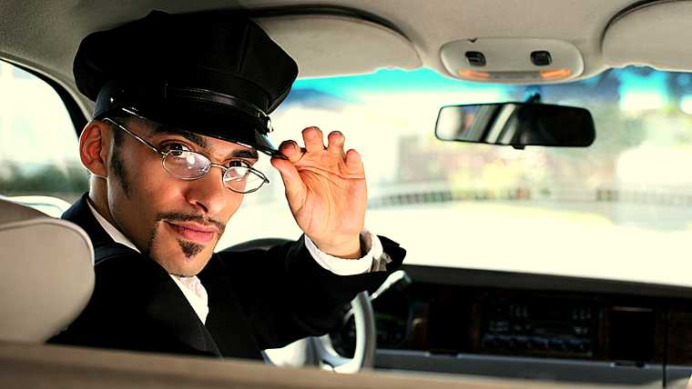 adult; attentive; black; brunette; business; cap; car; caucasian; chauffeur; day; drive; driver; face; formal; front; glasses; goatee; greeting; handsome; hat; head; intelligent; limo; limousine; looking; luxury; male; man; mustache; one; people; person; portrait; retro; ride; salute; saluting; seat; service; serving; shoulders; side; sideburns; sitting; smart; suit; taxi; transportation; uniform; vehicle; vintage; windshield; young;