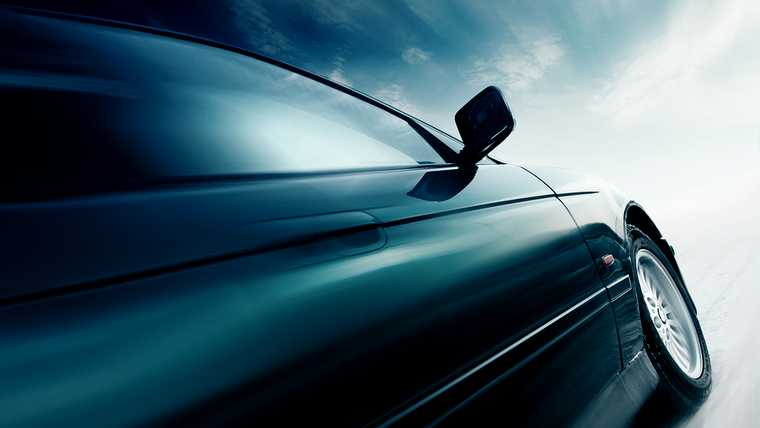 angle; automobile; back; blue; blur; car; clouds; crop; driving; fast; freight; high; highway; ice; iron; light; line; metal; middle; mirror; motion; moving; perspective; road; side; sky; speed; spot; sunlight; surface; tilt; traffic; transport; turn; urban; vehicle; view; way; wheel; white; wide; window;