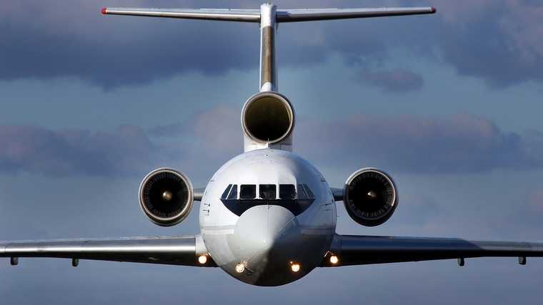42; aeroplane; aerospace; air; aircraft; airline; airliner; airplane; airport; aviation; away; background; blue; business; cargo; clouds; commercial; concept; corporate; detail; engine; flight; fly; flying; freight; high; industry; jet; journey; military; modern; passenger; plane; private; red; runway; sky; speed; sun; technology; three; tourism; transport; transportation; travel; vacation; view; white; wing; yak;